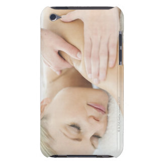 Woman relaxing at a spa while receiving a 2 iPod touch covers