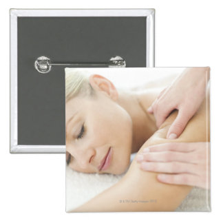 Woman relaxing at a spa while receiving a 2 pinback button