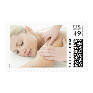 Woman relaxing at a spa while receiving a 2 postage