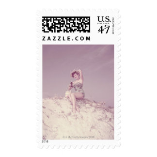 Woman Relaxing on Beach Postage