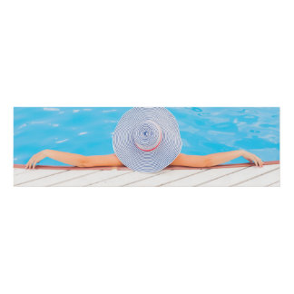 Woman relaxing on swimming pool edge… panel wall art