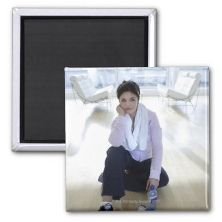 Woman resting on the floor after exercising. 2 inch square magnet