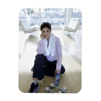 Woman resting on the floor after exercising. rectangular photo magnet