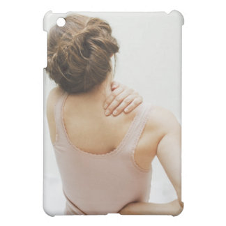 Woman rubbing aching back cover for the iPad mini