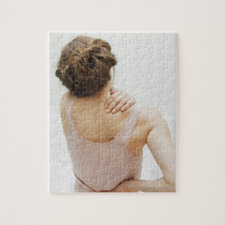 Woman rubbing aching back jigsaw puzzle
