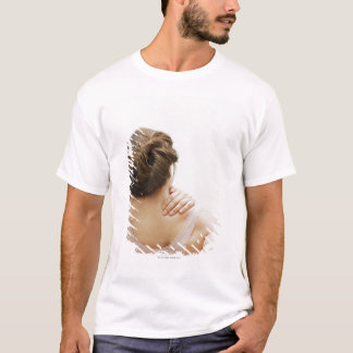 Woman rubbing aching back T-Shirt