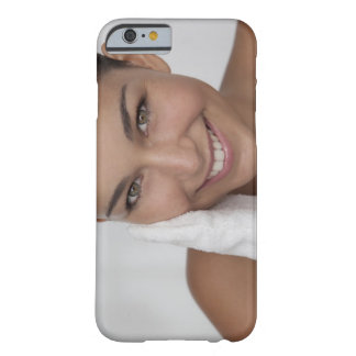 Woman scrubbing her face with cloth barely there iPhone 6 case