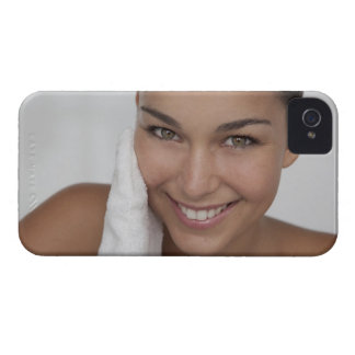 Woman scrubbing her face with cloth iPhone 4 Case-Mate case