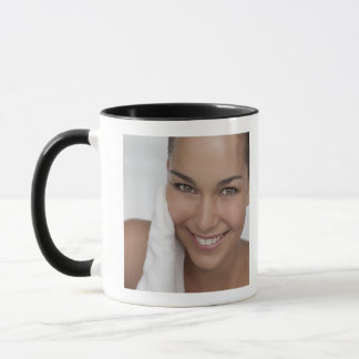 Woman scrubbing her face with cloth mug