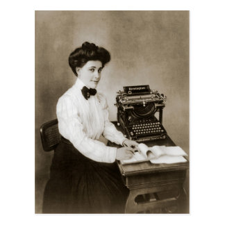 Woman seated at a desk with a vintage typewriter postcard