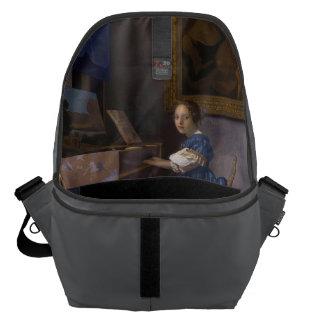 Woman Seated at a Virginal by Vermeer Inside Messenger Bag