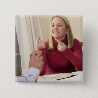 Woman signing the phrase 'What do you want to Pinback Button