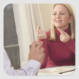 Woman signing the phrase 'What do you want to Square Sticker
