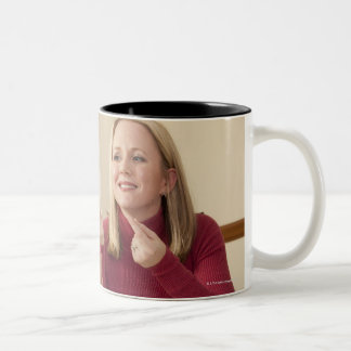 Woman signing the phrase 'What do you want to Two-Tone Coffee Mug