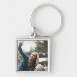 Woman signing the word 'Airplane' in American Key Chain
