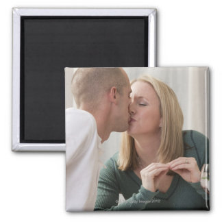 Woman signing the word 'Kiss' in American Sign Magnet