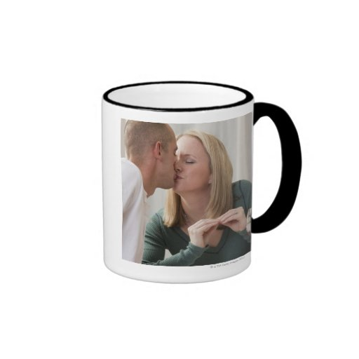 Woman signing the word 'Kiss' in American Sign Coffee Mugs