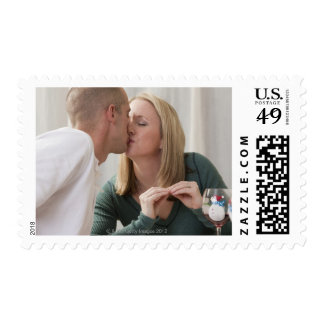 Woman signing the word 'Kiss' in American Sign Stamp