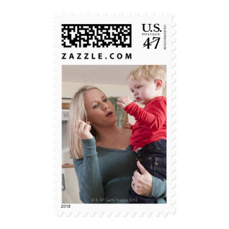 Woman signing the word 'Milk' in American Sign Postage