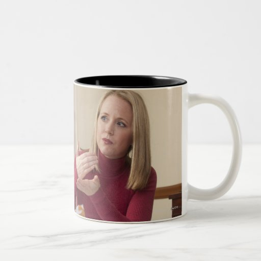 Woman signing the word 'Mortgage' in American Mug