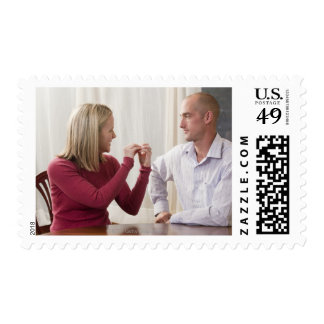 Woman signing word phrase 'Argument' in American Postage