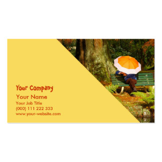 Woman siting with umbrella business card templates