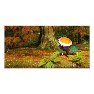 Woman siting with umbrella card