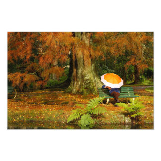 Woman siting with umbrella photo