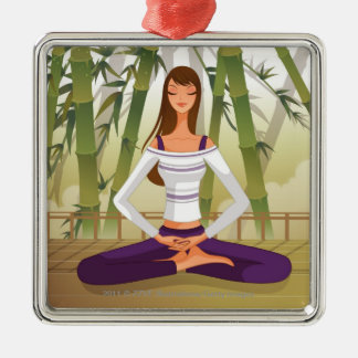Woman sitting in lotus position, meditating square metal christmas ornament