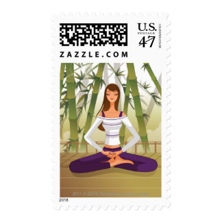 Woman sitting in lotus position, meditating postage