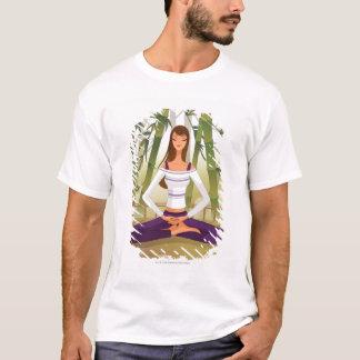 Woman sitting in lotus position, meditating T-Shirt