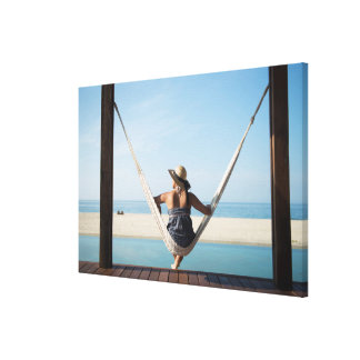 Woman Sitting On A Hammock At A Small Hotel Canvas Print