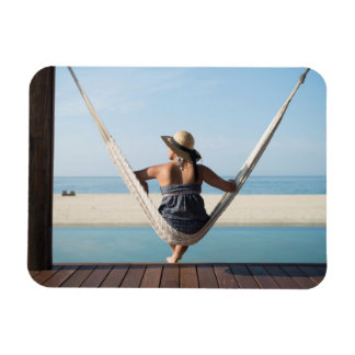 Woman Sitting On A Hammock At A Small Hotel Magnet