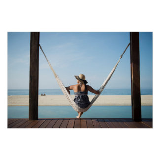 Woman Sitting On A Hammock At A Small Hotel Poster