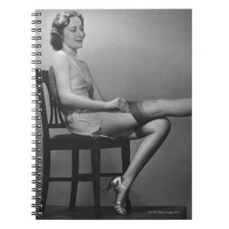 Woman Sitting on Chair Spiral Notebooks