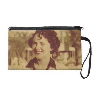 Woman Sitting Outside Wristlet Clutches