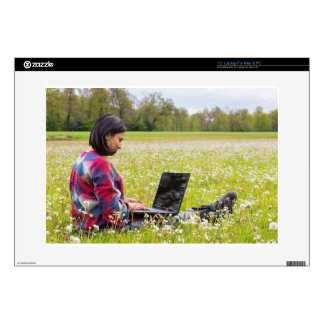 """Woman sitting with laptop in spring meadow skins for 15"""" laptops"""