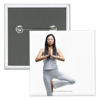 Woman standing in yoga position pinback buttons