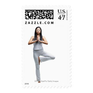 Woman standing in yoga position postage