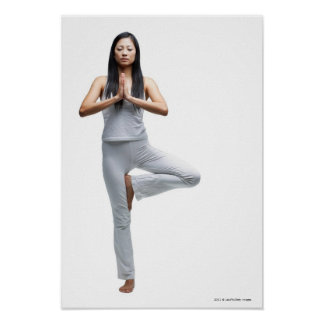 Woman standing in yoga position posters