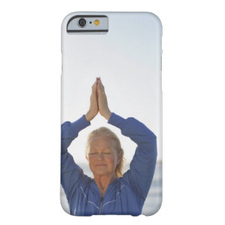Woman standing with hands clasped overhead barely there iPhone 6 case