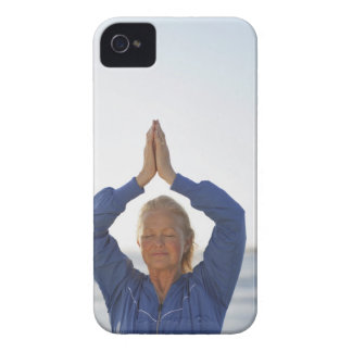 Woman standing with hands clasped overhead iPhone 4 Case-Mate case