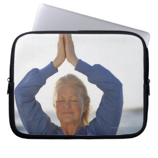 Woman standing with hands clasped overhead laptop computer sleeves
