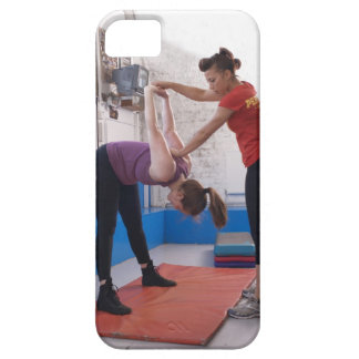 Woman stretching with trainer in gym iPhone SE/5/5s case