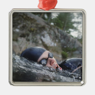 Woman swimming, close-up metal ornament