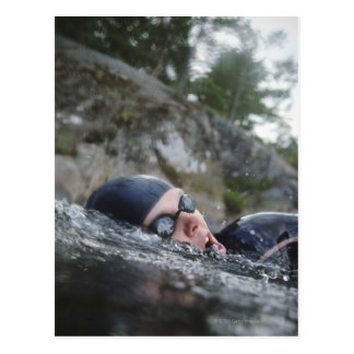 Woman swimming, close-up postcard