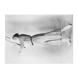 Woman Swinging Tennis Raquet Canvas Print