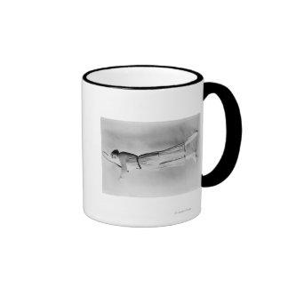 Woman Swinging Tennis Raquet Coffee Mug