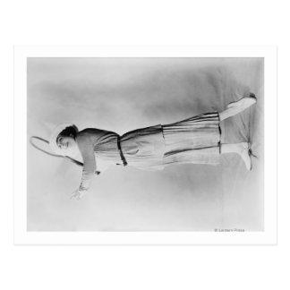 Woman Swinging Tennis Raquet Postcard