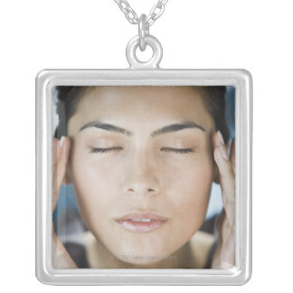 Woman taking a spa treatment square pendant necklace